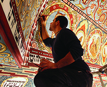 Jason Loik retouches the ceiling painting of the Gwoździec after the installation in the POLIN Museum of the History of Polish Jews, Warsaw, Poland, 2013.